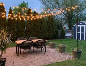 potted base idea for lighting up your outdoor with string lights
